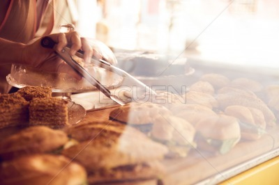 Deli display of cookies, cakes, pasties