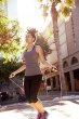 Fit woman skipping with jump rope