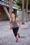 Fit young female running in city