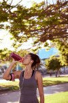 Fit young woman drinking some water