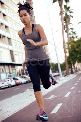 Fit woman running on the road
