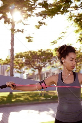 Fit woman stretching with jumping rope