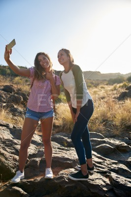 Girls on a rock taking selfies