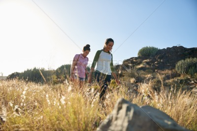 Healthy girls walking down a hill