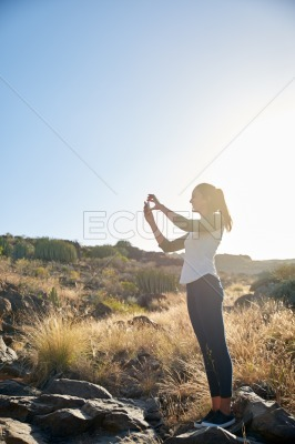 Lovely young woman taking a photo