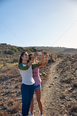 Pretty young girls taking a picture