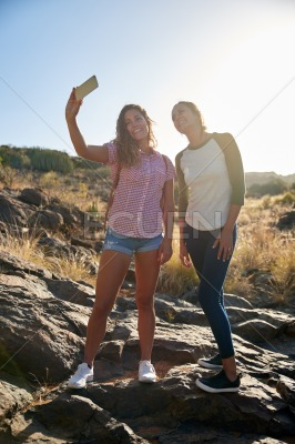 Two girls on a rock posing