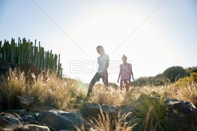 Two girls on a rocky hill