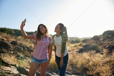 Two girls on a rocky ourpost