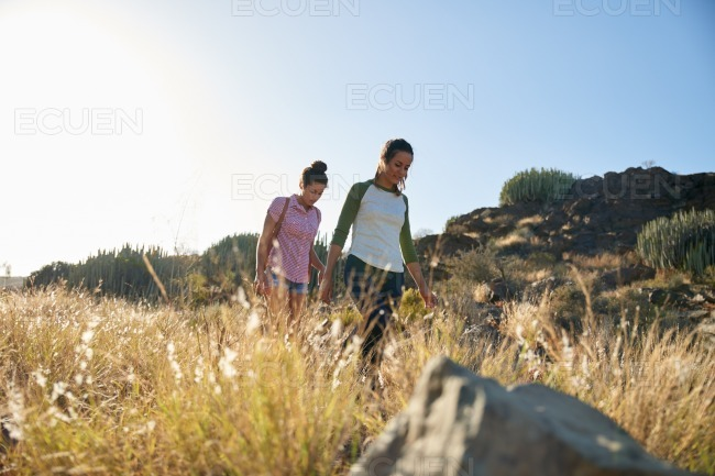Healthy girls walking down a hill stock photo