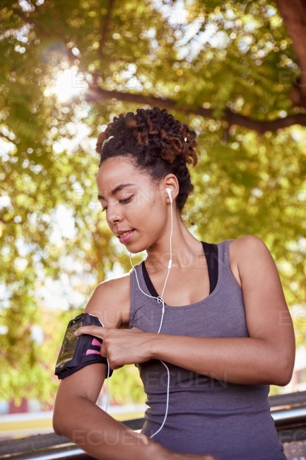 Relaxed young woman with music player stock photo