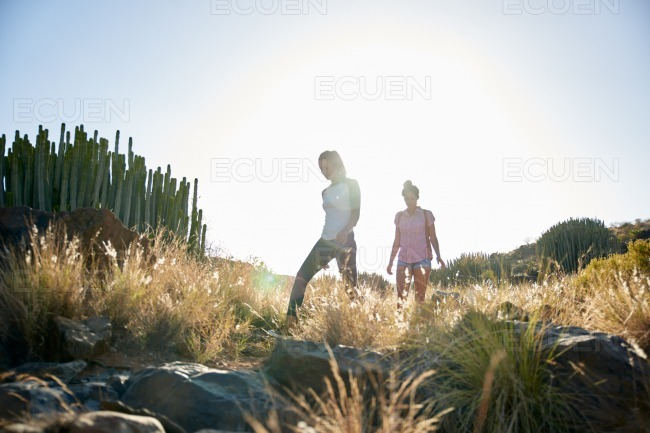 Two girls on a rocky hill stock photo