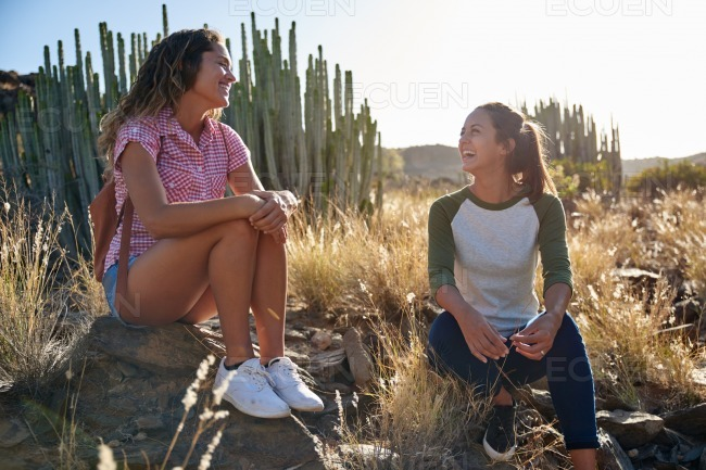 Two hiking girls taking a rest stock photo