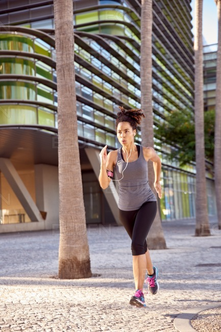 Woman in training doing some running stock photo