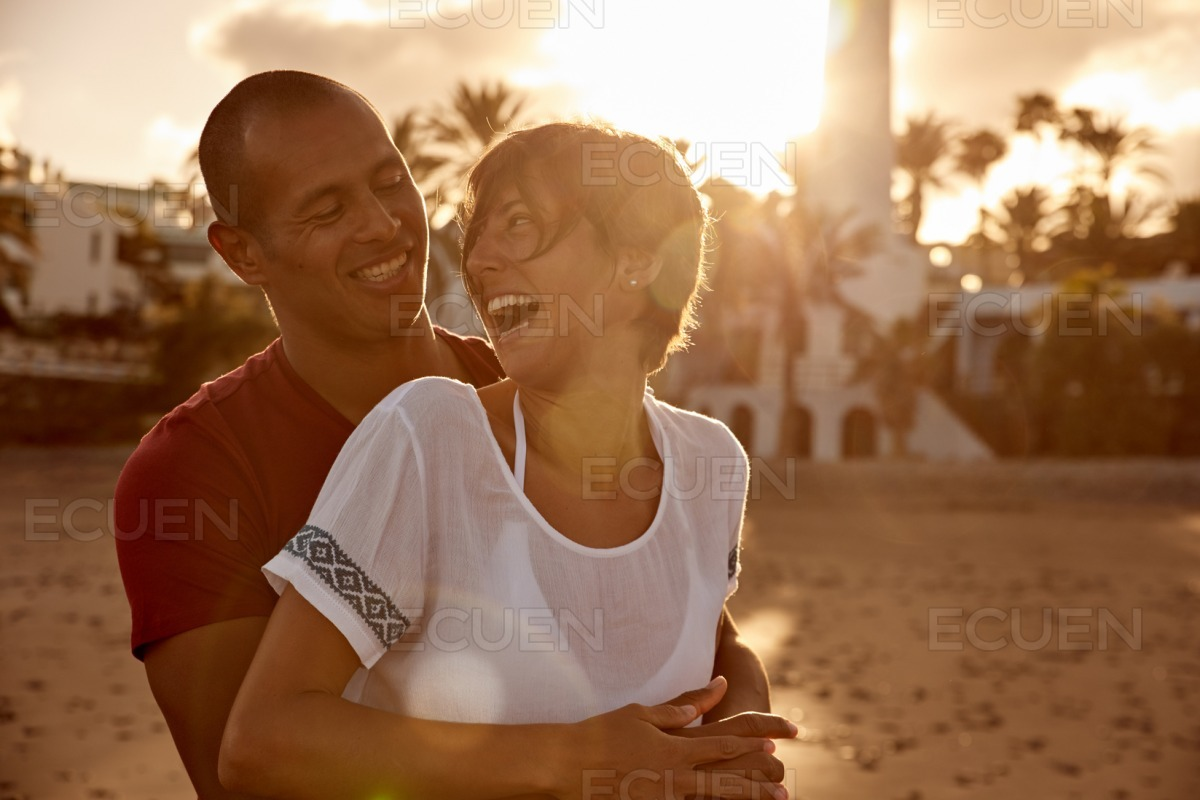 Loving adult couple cackling with laughter stock photo