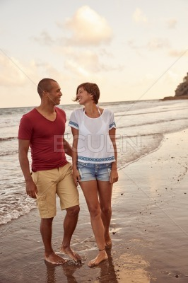 Awesome loving couple walking on beach