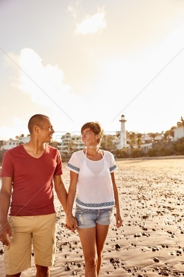 Couple in love strolling the beach