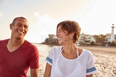 Couple laughing with joy on beach