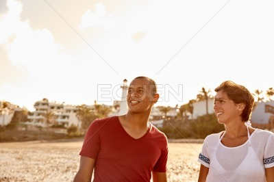 Couple loving their stroll on beach