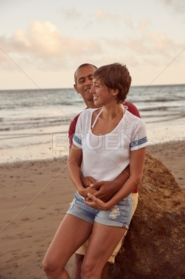Embracing adult lovers on the beach