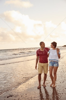 Intimate couple in the breaking waves