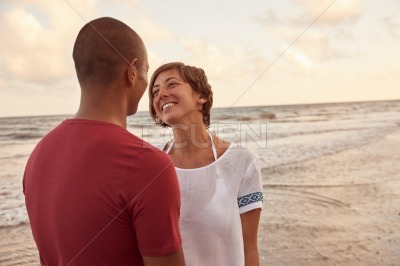 Joyous couple laughing with much love