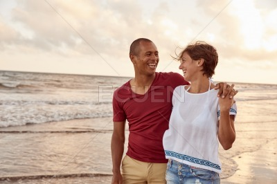 Joyously laughing couple on the beach