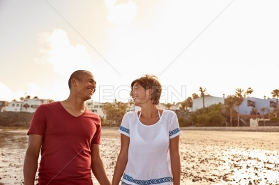 Laughing couple looking at each other