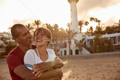 Laughing happy couple on the beach