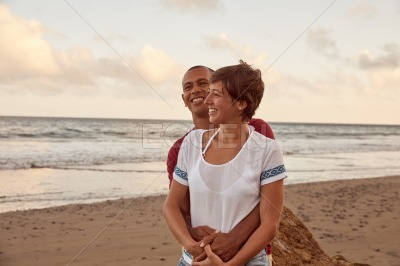 Lovers on a rock at beach