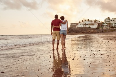 Lovers strolling home into the sunset