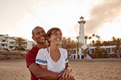 Loving adult couple laughing with happiness