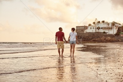 Relaxed couple strolling on the beach