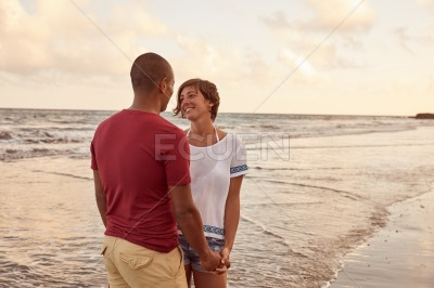 Very intimate loving moment on beach