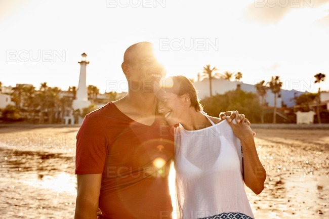 Embracing adult couple sharing a moment stock photo