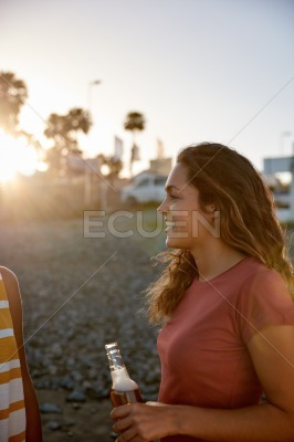 Woman with a beer on the beach