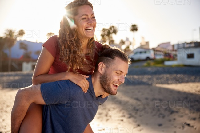 Woman getting a piggy back ride stock photo