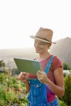 Smiling girl with ipad in sunlight
