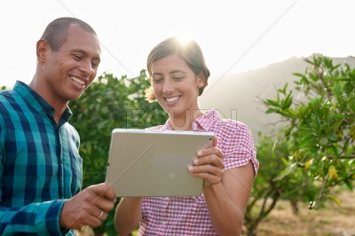 Cute young couple looking at tablet