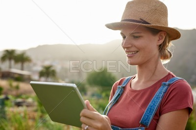 Interested woman looking at her ipad