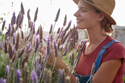 Lovely young female farmer with lavender