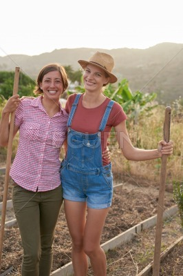 Satisfied female farmers posing for camera