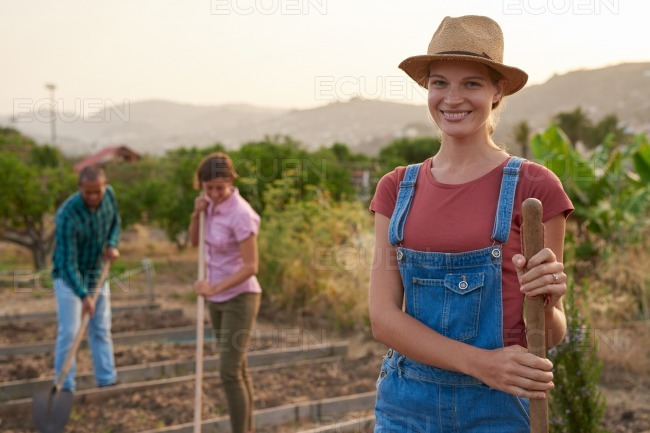 Friendly female farmer posing for camera stock photo