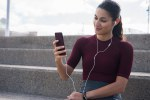 Young sporty brunette with mobile phone