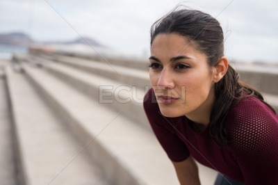Attractive sporty woman looking into the distance