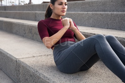 Attractive young woman exercising on stairs