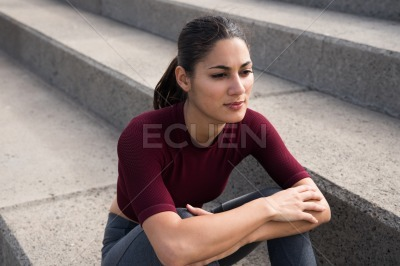 Attractive young woman sitting on stairs