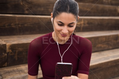 Pretty young brunette looking at her phone
