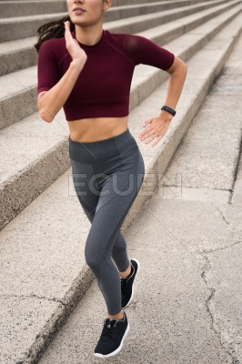 Sporty brunette running next to stairs
