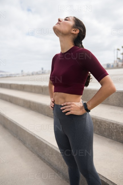 Pretty fit brunette taking a work out break stock photo